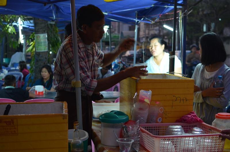 yogurt stand in outdoor market near Diamond Plaza, photo taken by Alex