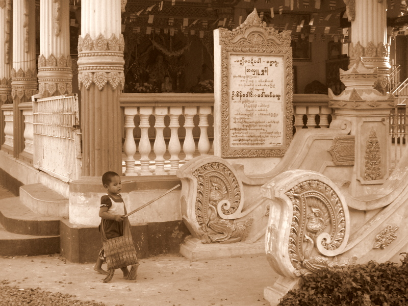little girl outside of a Mandalay temple