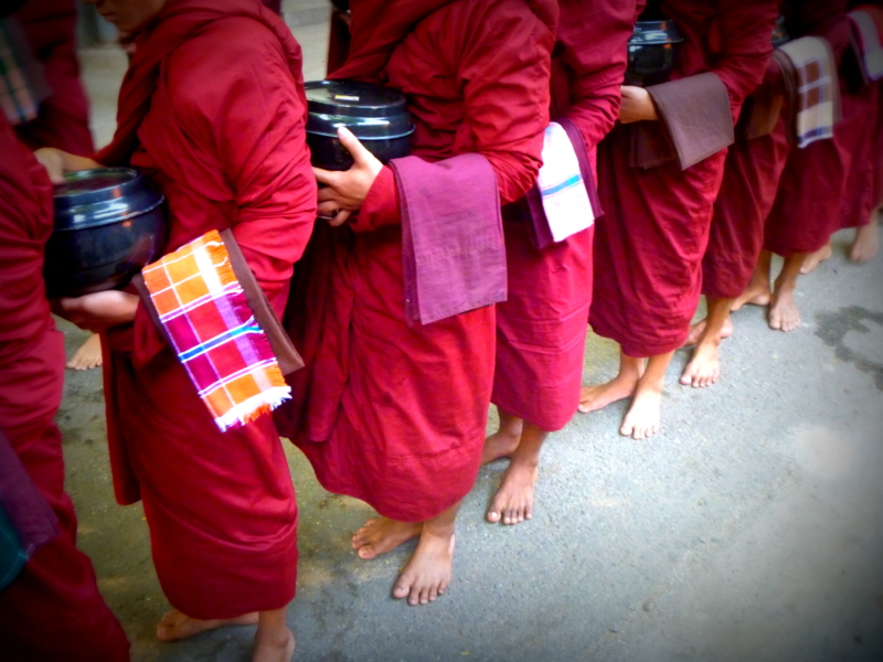 Monks awaiting their last meal of the day